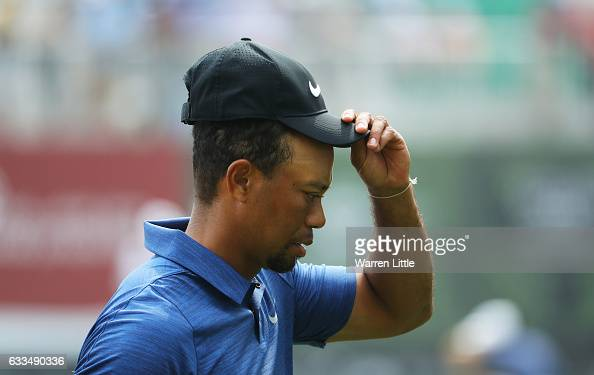 Tiger Woods of the United States looks on from the 9th green as he finishes his round during the first round of the Omega Dubai Desert Classic at...