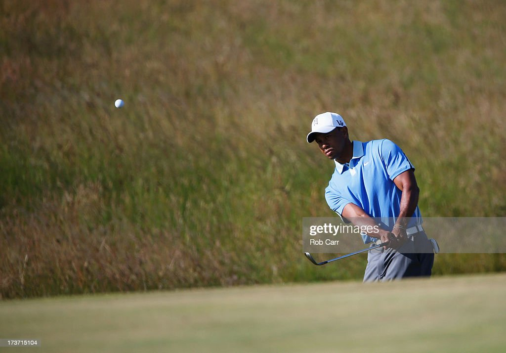 Tiger Woods of the United States plays a chip shot ahead of the 142nd Open Championship at Muirfield on July 17, 2013 in Gullane, Scotland.