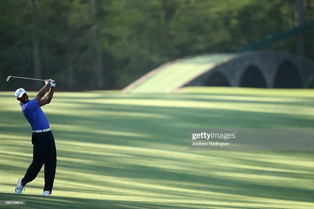 <a gi-track='captionPersonalityLinkClicked' href=/galleries/search?phrase=Tiger+Woods&family=editorial&specificpeople=157537 ng-click='$event.stopPropagation()'>Tiger Woods</a> of the United States plays a shot during a practice round prior to the start of the 2013 Masters Tournament at Augusta National Golf Club on April 10, 2013 in Augusta, Georgia.