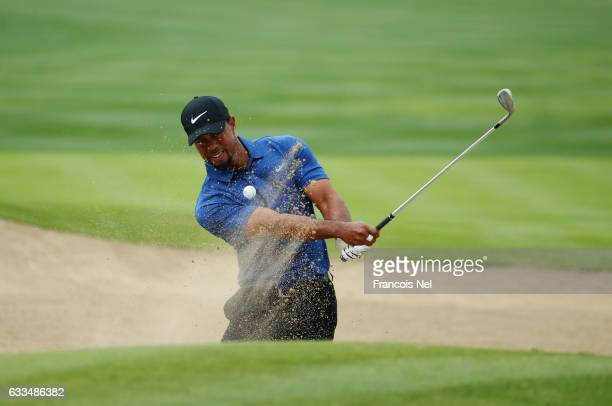 Tiger Woods of the United States plays from a bunker on the 6th hole during the first round of the Omega Dubai Desert Classic at Emirates Golf Club...