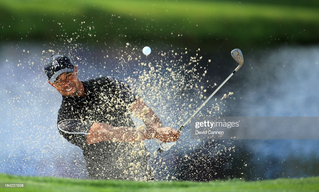 <a gi-track='captionPersonalityLinkClicked' href=/galleries/search?phrase=Tiger+Woods&family=editorial&specificpeople=157537 ng-click='$event.stopPropagation()'>Tiger Woods</a> of the United States plays his second shot at the par 3, 17th hole during the first round of the 2013 Arnold Palmer Invitational Presented by Mastercard at Bay Hill Golf and Country Club on March 21, 2013 in Orlando, Florida.