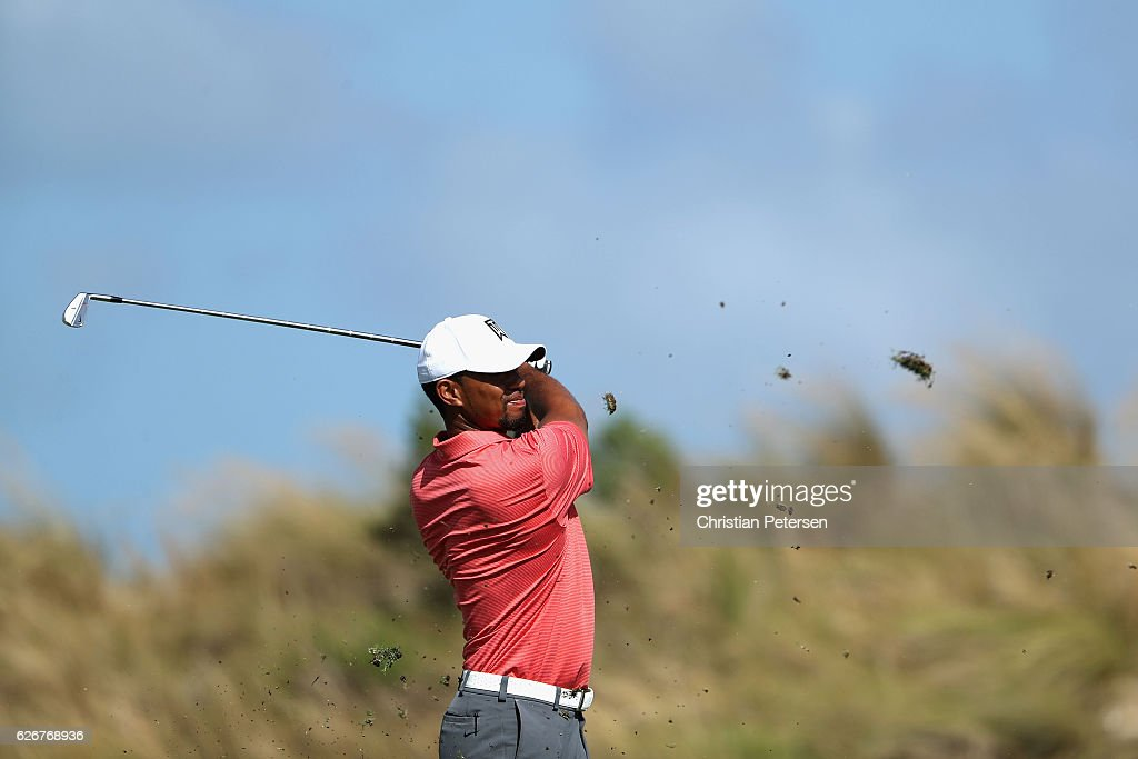 Tiger Woods of the United States plays his second shot on the 16th hole during the pro-am ahead of the Hero World Challenge at Albany, The Bahamas on November 30, 2016 in Nassau, Bahamas.