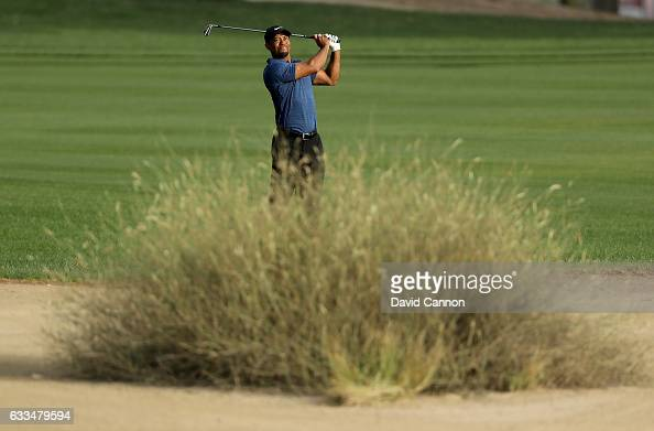Tiger Woods of the United States plays his second shot to the par 5 10th hole during the first round of the 2017 Omega Dubai Desert Classic on the...