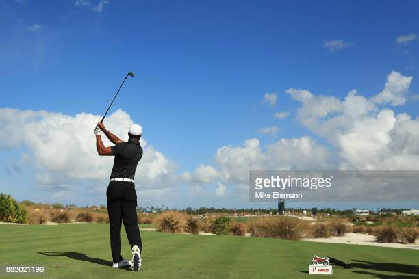 Tiger Woods of the United States plays his shot from the eighth tee during the first round of the Hero World Challenge at Albany Bahamas on November...