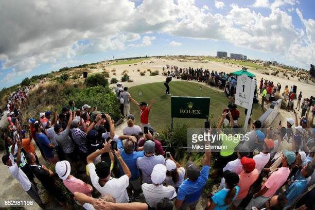 Tiger Woods of the United States plays his shot from the first tee during the first round of the Hero World Challenge at Albany Bahamas on November...