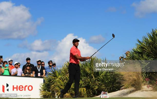 Tiger Woods of the United States plays his shot from the fourth tee during the final round of the Hero World Challenge at Albany Bahamas on December...