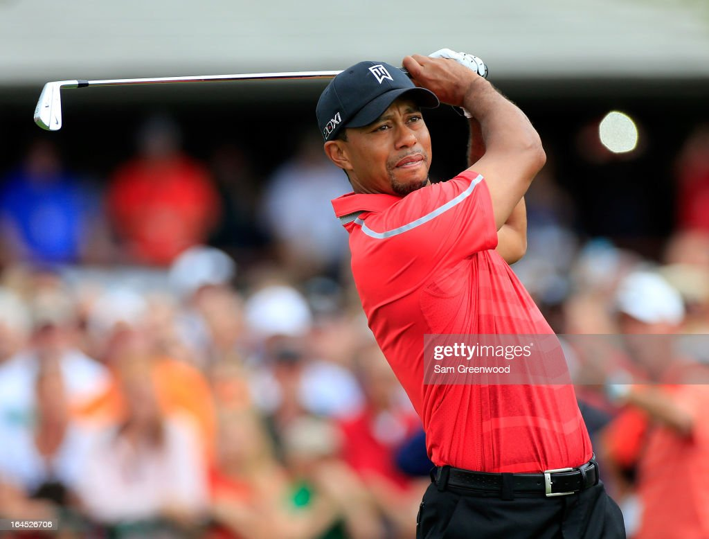 <a gi-track='captionPersonalityLinkClicked' href=/galleries/search?phrase=Tiger+Woods&family=editorial&specificpeople=157537 ng-click='$event.stopPropagation()'>Tiger Woods</a> of the United States plays his tee shot at the par 4, 1st hole during the final round of the 2013 Arnold Palmer Invitational Presented by Mastercard at Bay Hill Golf and Country Club on March 24, 2013 in Orlando, Florida.