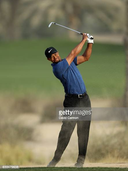 Tiger Woods of the United States plays his third shot to the par 5 10th hole during the first round of the 2017 Omega Dubai Desert Classic on the...