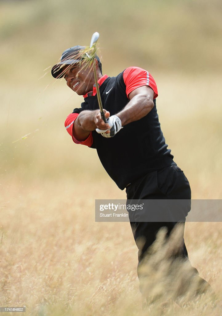 <a gi-track='captionPersonalityLinkClicked' href=/galleries/search?phrase=Tiger+Woods&family=editorial&specificpeople=157537 ng-click='$event.stopPropagation()'>Tiger Woods</a> of the United States plays out of the rough on the 5th hole during the final round of the 142nd Open Championship at Muirfield on July 21, 2013 in Gullane, Scotland.