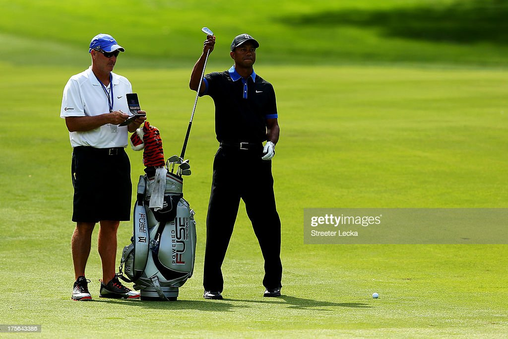 <a gi-track='captionPersonalityLinkClicked' href=/galleries/search?phrase=Tiger+Woods&family=editorial&specificpeople=157537 ng-click='$event.stopPropagation()'>Tiger Woods</a> of the United States pulls a club during a practice round prior to the start of the 95th PGA Championship at Oak Hill Country Club on August 5, 2013 in Rochester, New York.