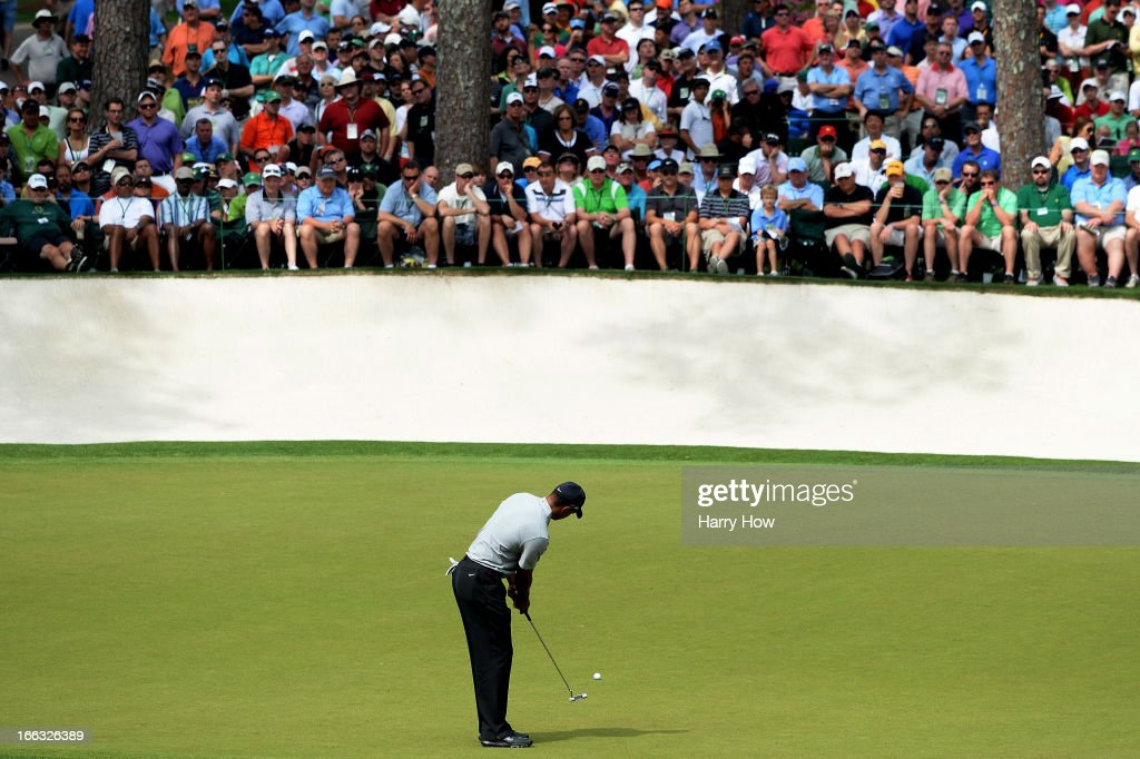 Tiger Woods of the United States putts on the 16th hole during the first round of the 2013 Masters Tournament at Augusta National Golf Club on April 11, 2013 in Augusta, Georgia.