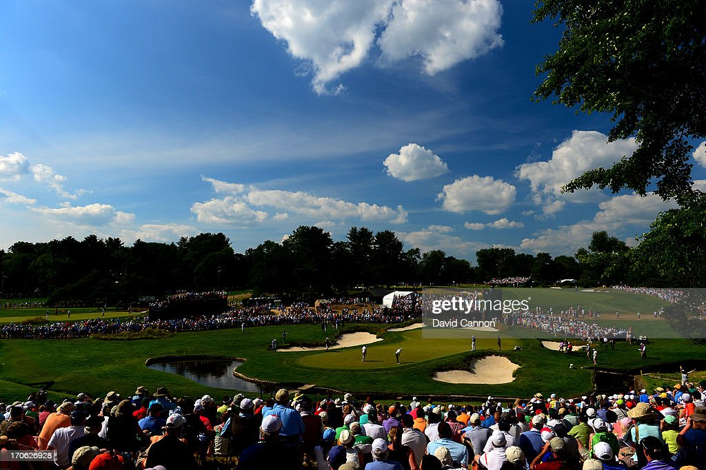 <a gi-track='captionPersonalityLinkClicked' href=/galleries/search?phrase=Tiger+Woods&family=editorial&specificpeople=157537 ng-click='$event.stopPropagation()'>Tiger Woods</a> of the United States putts on the ninth green during Round Three of the 113th U.S. Open at Merion Golf Club on June 15, 2013 in Ardmore, Pennsylvania.