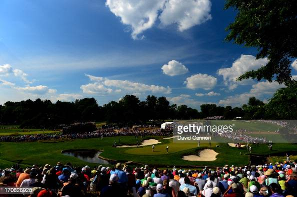 Tiger Woods of the United States putts on the ninth green during Round Three of the 113th US Open at Merion Golf Club on June 15 2013 in Ardmore...