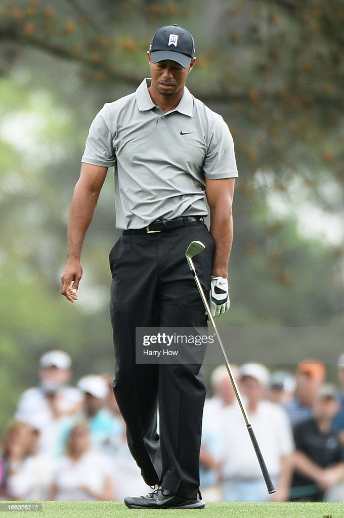 Tiger Woods of the United States reacts after hitting his second shot on the 15th hole during the first round of the 2013 Masters Tournament at Augusta National Golf Club on April 11, 2013 in Augusta, Georgia.