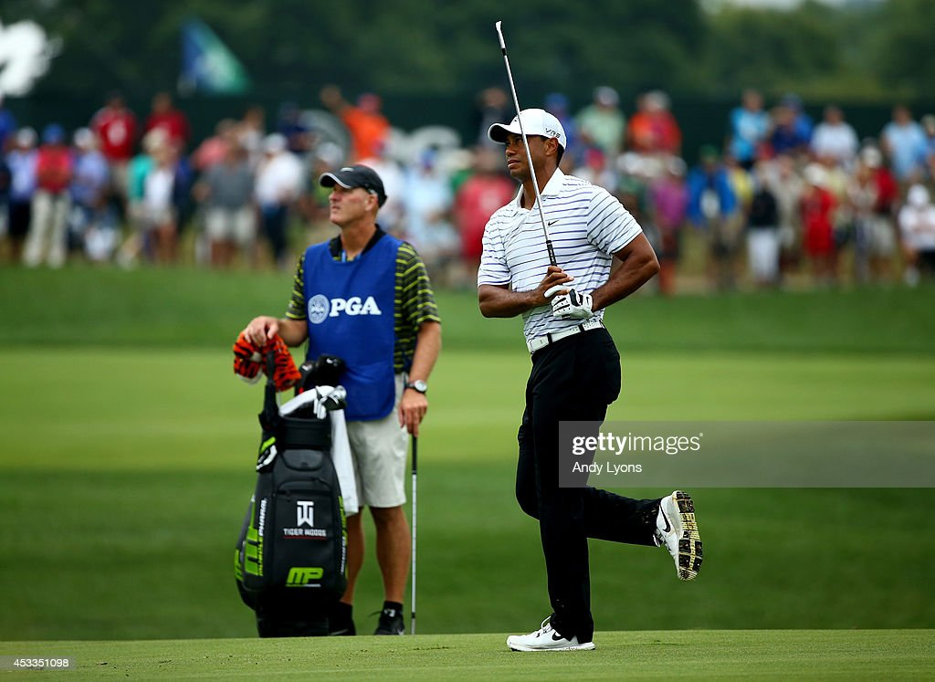 Tiger Woods of the United States reacts after hitting his second shot on the seventh hole during the second round of the 96th PGA Championship at Valhalla Golf Club on August 8, 2014 in Louisville, Kentucky.