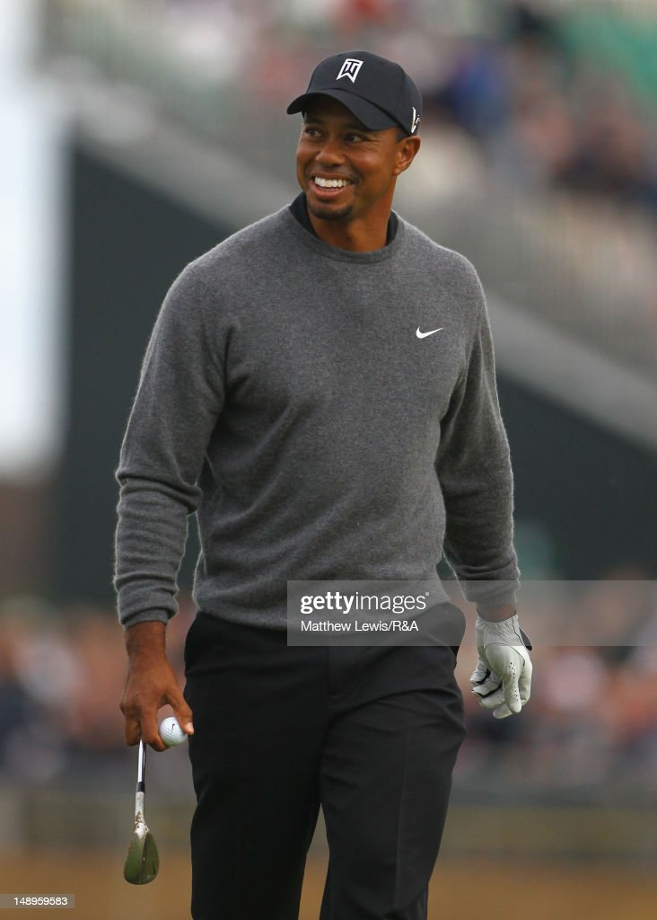 <a gi-track='captionPersonalityLinkClicked' href=/galleries/search?phrase=Tiger+Woods&family=editorial&specificpeople=157537 ng-click='$event.stopPropagation()'>Tiger Woods</a> of the United States reacts after holing a bunker shot for a birdie on the 18th hole during the second round of the 141st Open Championship at Royal Lytham & St Annes Golf Club on July 20, 2012 in Lytham St Annes, England.