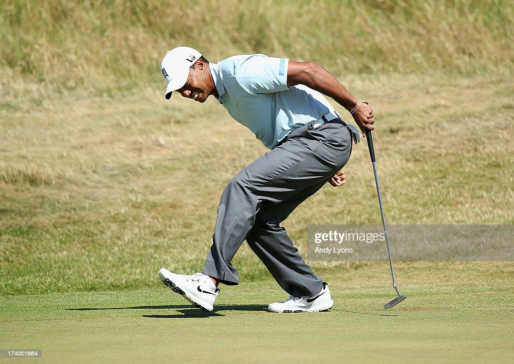 Tiger Woods of the United States reacts after missing a birdie putt on the 9th hole during the second round of the 142nd Open Championship at Muirfield on July 19, 2013 in Gullane, Scotland.