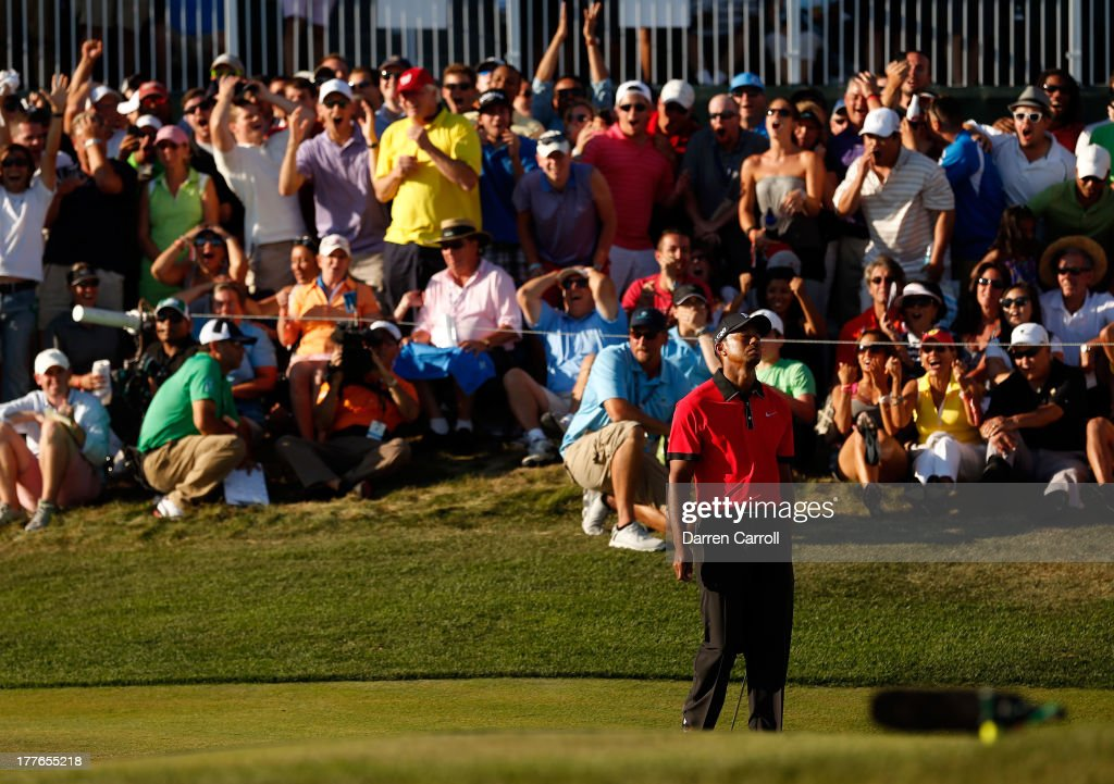 Tiger Woods of the United States reacts after missing a putt on the 18th hole during the final round of The Barclays at Liberty National Golf Club on August 25, 2013 in Jersey City, New Jersey.