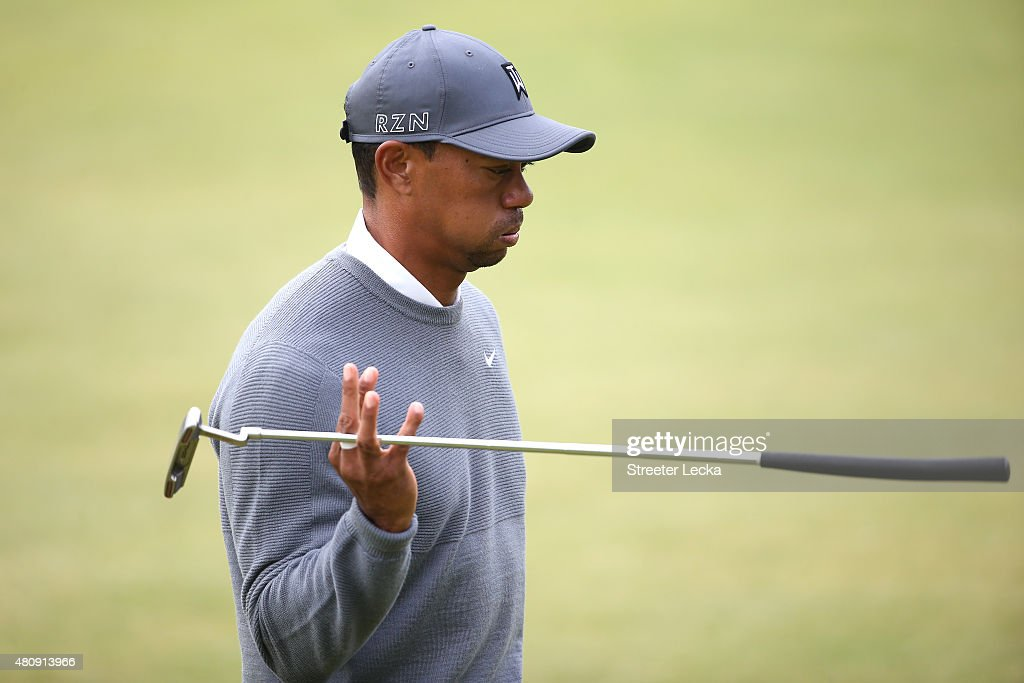 Tiger Woods of the United States reacts as he walks off of the 18th green during the first round of the 144th Open Championship at The Old Course on...