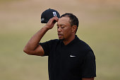 Tiger Woods of the United States reacts on the 18th green during the first round of the 115th US Open Championship at Chambers Bay on June 18 2015 in...