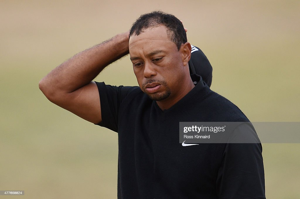 <a gi-track='captionPersonalityLinkClicked' href=/galleries/search?phrase=Tiger+Woods&family=editorial&specificpeople=157537 ng-click='$event.stopPropagation()'>Tiger Woods</a> of the United States reacts on the 18th green during the first round of the 115th U.S. Open Championship at Chambers Bay on June 18, 2015 in University Place, Washington.