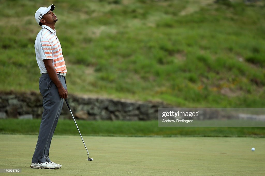 Tiger Woods of the United States reacts on the ninth green during Round Two of the 113th US Open at Merion Golf Club on June 14 2013 in Ardmore...