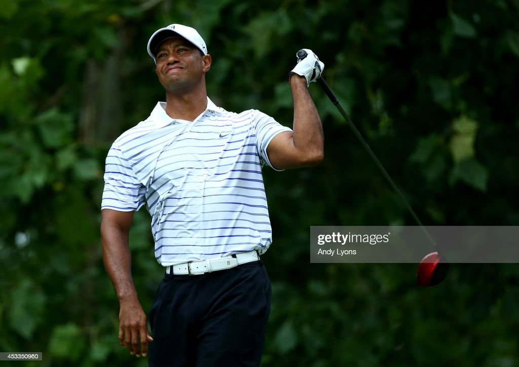 <a gi-track='captionPersonalityLinkClicked' href=/galleries/search?phrase=Tiger+Woods&family=editorial&specificpeople=157537 ng-click='$event.stopPropagation()'>Tiger Woods</a> of the United States reacts on the seventh tee during the second round of the 96th PGA Championship at Valhalla Golf Club on August 8, 2014 in Louisville, Kentucky.