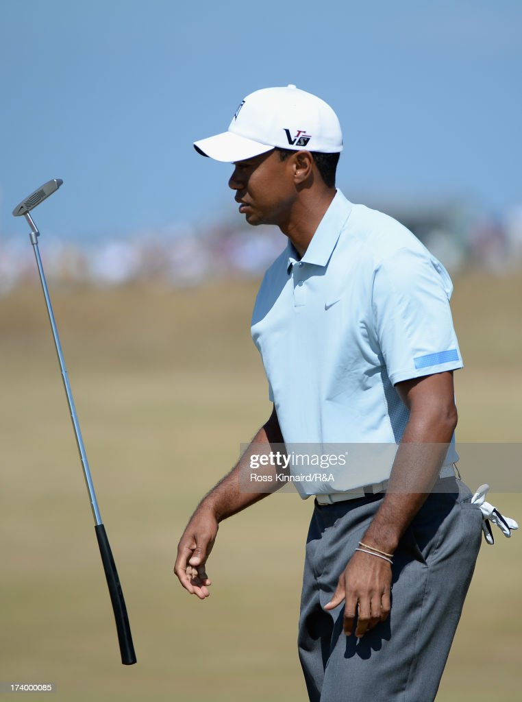 <a gi-track='captionPersonalityLinkClicked' href=/galleries/search?phrase=Tiger+Woods&family=editorial&specificpeople=157537 ng-click='$event.stopPropagation()'>Tiger Woods</a> of the United States reacts to a missed putt on the 8th green during the second round of the 142nd Open Championship at Muirfield on July 19, 2013 in Gullane, Scotland.