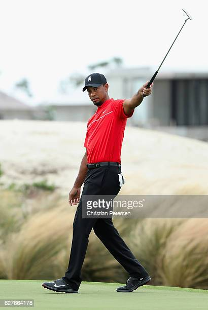 Tiger Woods of the United States reacts to a missed putt on the third hole during the final round of the Hero World Challenge at Albany The Bahamas...