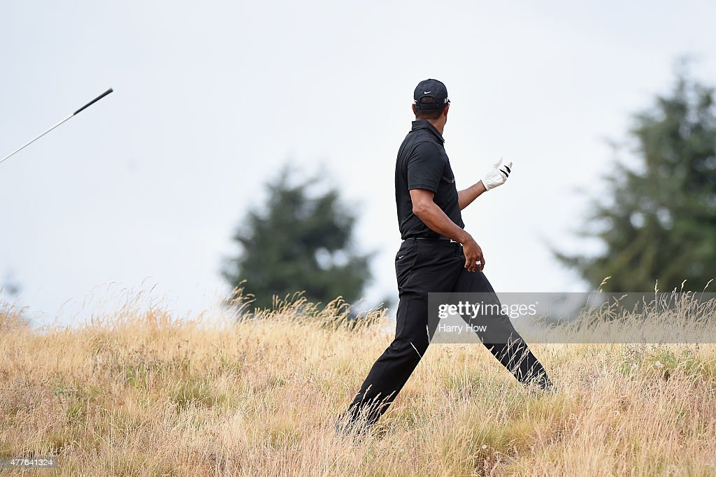 Tiger Woods of the United States reacts to a shot from the rough on the eighth hole during the first round of the 115th U.S. Open Championship at Chambers Bay on June 18, 2015 in University Place, Washington.