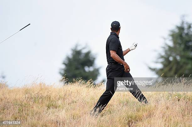 Tiger Woods of the United States reacts to a shot from the rough on the eighth hole during the first round of the 115th US Open Championship at...