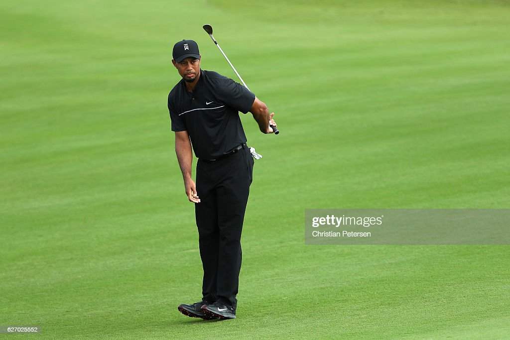 Tiger Woods of the United States reacts to his second shot on the 13th hole during round one of the Hero World Challenge at Albany, The Bahamas on December 1, 2016 in Nassau, Bahamas.