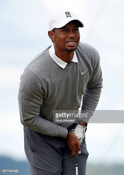 Tiger Woods of the United States reacts to his tee shot on the 12th hole during the second round of the 115th US Open Championship at Chambers Bay on...