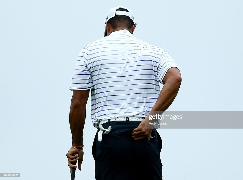 <a gi-track='captionPersonalityLinkClicked' href=/galleries/search?phrase=Tiger+Woods&family=editorial&specificpeople=157537 ng-click='$event.stopPropagation()'>Tiger Woods</a> of the United States rubs his back before hitting his second shot on the 17th hole during the second round of the 96th PGA Championship at Valhalla Golf Club on August 8, 2014 in Louisville, Kentucky.