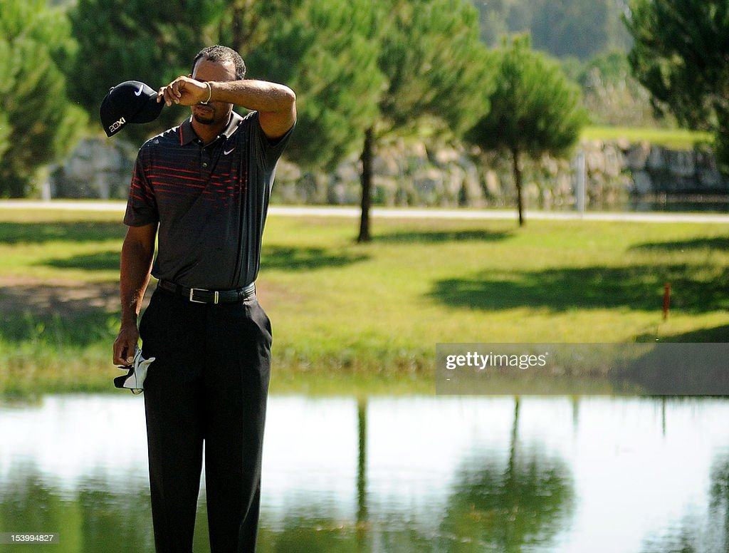 Tiger Woods of the United States rubs his brow during his match against Ahmet Agaoglu of Turkey on October 12, 2012 at the World Golf Final on the Sultan Course at the Antalya Club.