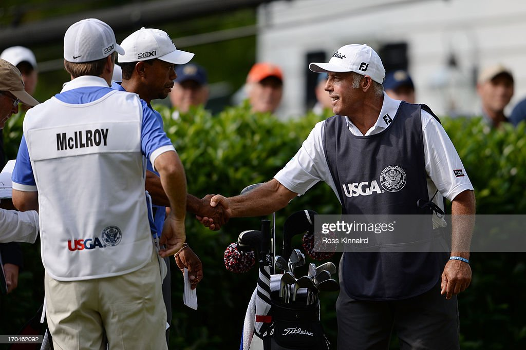 Tiger Woods of the United States shakes hands with Steve Williams prior to teeing off during Round One of the 113th US Open at Merion Golf Club on...