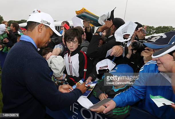 Tiger Woods of the United States signs autographs during the second practice round prior to the start of the 141st Open Championship at Royal Lytham...