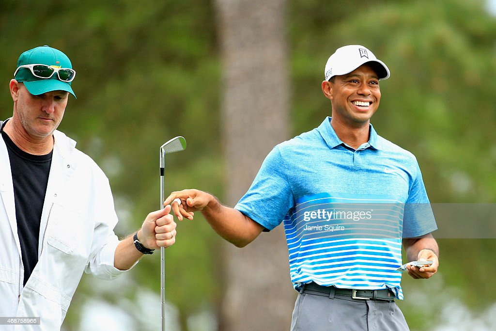 <a gi-track='captionPersonalityLinkClicked' href=/galleries/search?phrase=Tiger+Woods&family=editorial&specificpeople=157537 ng-click='$event.stopPropagation()'>Tiger Woods</a> of the United States smiles as he hands his club to caddie <a gi-track='captionPersonalityLinkClicked' href=/galleries/search?phrase=Joe+LaCava&family=editorial&specificpeople=695531 ng-click='$event.stopPropagation()'>Joe LaCava</a> during a practice round prior to the start of the 2015 Masters Tournament at Augusta National Golf Club on April 6, 2015 in Augusta, Georgia.