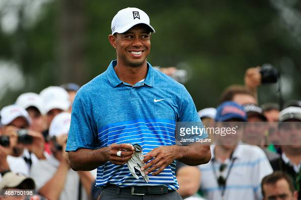 Tiger Woods of the United States smiles as patrons look on during a practice round prior to the start of the 2015 Masters Tournament at Augusta...