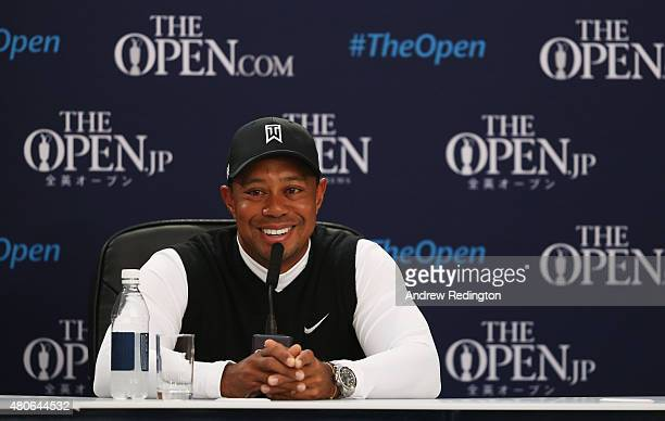 Tiger Woods of the United States smiles during a press conference ahead of the 144th Open Championship at The Old Course on July 14 2015 in St...