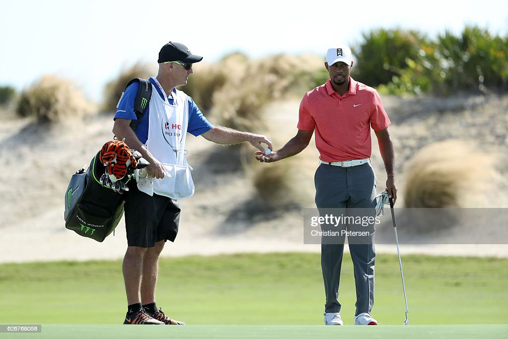 Tiger Woods of the United States takes a ball from his caddie Joe LaCava on the 15th hole during the pro-am ahead of the Hero World Challenge at Albany, The Bahamas on November 30, 2016 in Nassau, Bahamas.