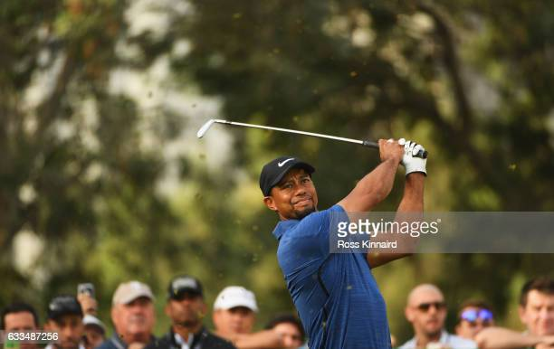 Tiger Woods of the United States tees off on the 11th hole during the first round of the Omega Dubai Desert Classic at Emirates Golf Club on February...