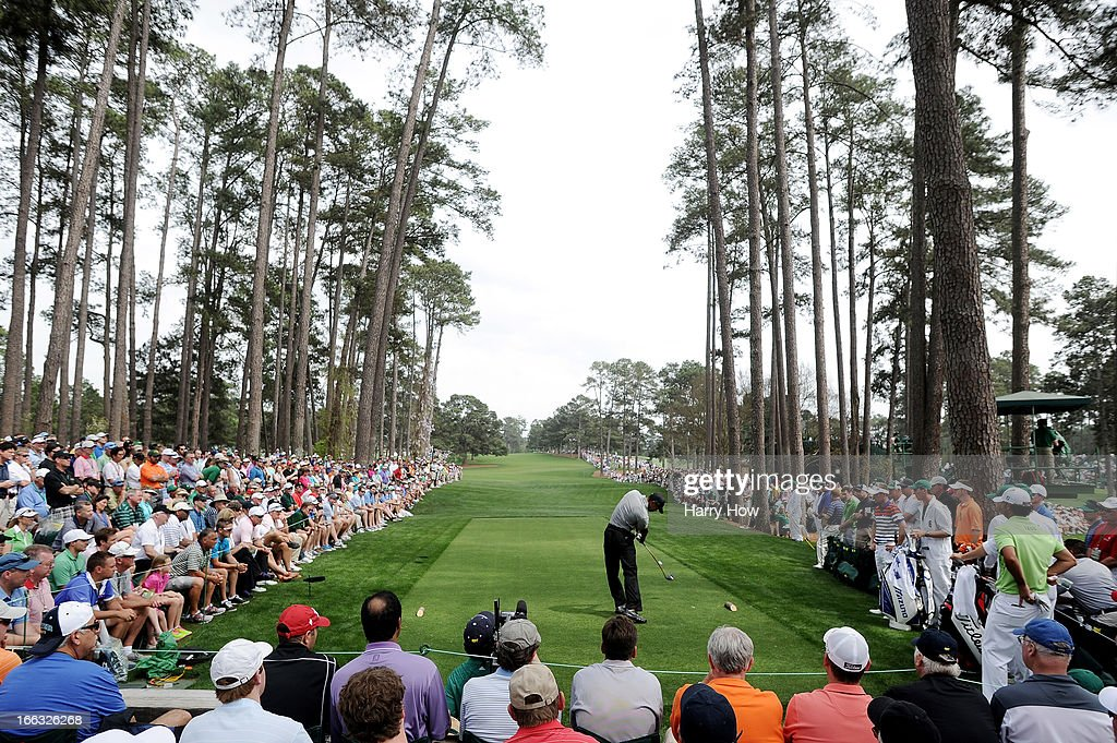 Tiger Woods of the United States tees off on the 17th hole during the first round of the 2013 Masters Tournament at Augusta National Golf Club on April 11, 2013 in Augusta, Georgia.