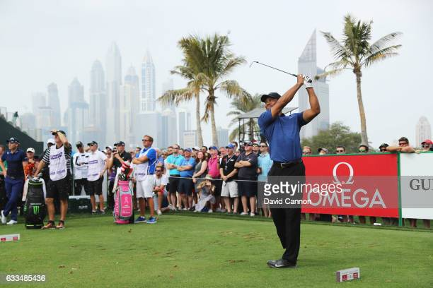 Tiger Woods of the United States tees off on the 4th hole during the first round of the Omega Dubai Desert Classic at Emirates Golf Club on February...