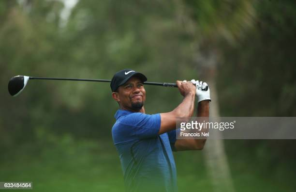 Tiger Woods of the United States tees off on the 5th hole during the first round of the Omega Dubai Desert Classic at Emirates Golf Club on February...
