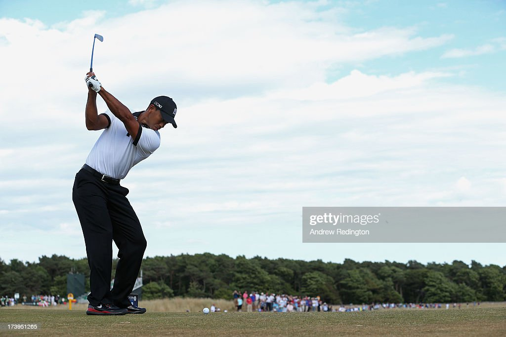 <a gi-track='captionPersonalityLinkClicked' href=/galleries/search?phrase=Tiger+Woods&family=editorial&specificpeople=157537 ng-click='$event.stopPropagation()'>Tiger Woods</a> of the United States tees off on the 8th hole during the first round of the 142nd Open Championship at Muirfield on July 18, 2013 in Gullane, Scotland.