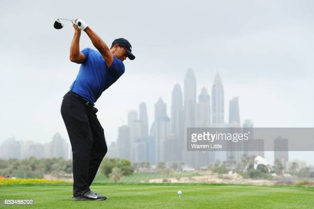 Tiger Woods of the United States tees off on the 8th hole during the first round of the Omega Dubai Desert Classic at Emirates Golf Club on February...