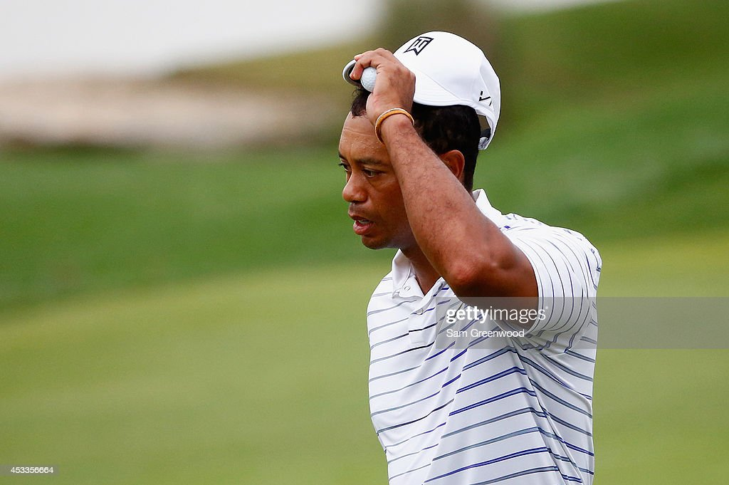 <a gi-track='captionPersonalityLinkClicked' href=/galleries/search?phrase=Tiger+Woods&family=editorial&specificpeople=157537 ng-click='$event.stopPropagation()'>Tiger Woods</a> of the United States tips his cap after playing the 18th hole during the second round of the 96th PGA Championship at Valhalla Golf Club on August 8, 2014 in Louisville, Kentucky.