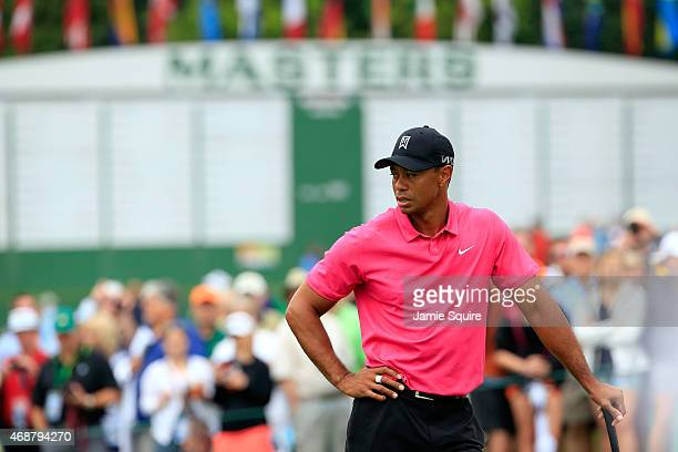 Tiger Woods of the United States waits on a green during a practice round prior to the start of the 2015 Masters Tournament at Augusta National Golf...