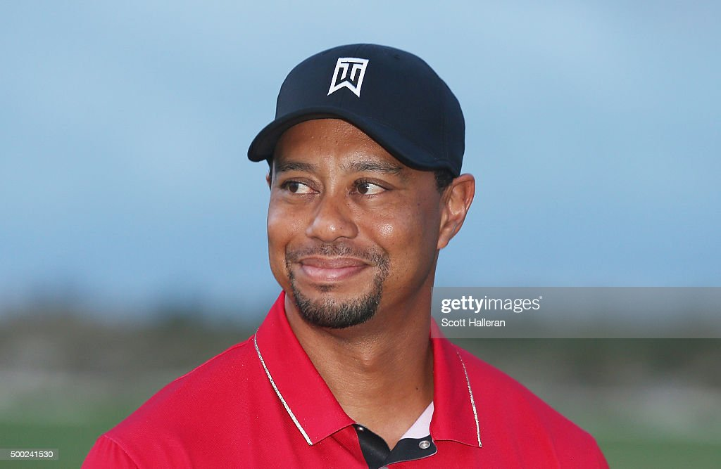 <a gi-track='captionPersonalityLinkClicked' href=/galleries/search?phrase=Tiger+Woods&family=editorial&specificpeople=157537 ng-click='$event.stopPropagation()'>Tiger Woods</a> of the United States waits on the 18th green after the final round of the Hero World Challenge at Albany, The Bahamas on December 6, 2015 in Nassau, Bahamas